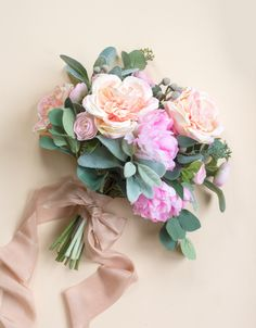 Learn how to wrap a bouquet in three ways- the Formal Wrap, Romantic Bow, and Layered Wrap.  After this simple wedding tutorial you will be able to finish your handmade bouquet like a pro! This How To is perfect for any bride-to-be looking to make her own wedding bouquets.