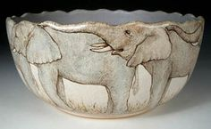 """Elephants are herbivores. Watch out when you serve salad in this bowl; those trunks may come over the rim. This stoneware bowl is 3 1/2"""" high and 7 1/4"""" wide. This pot sold for $350."""