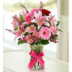 """With gorgeous collection of red and pink roses, lilies, #Gerbera #daisies and alstroemeria, this """"field-gathered"""" bouquet in a clear glass vase. #Flowers Delivery to Athens Greece Flowers Papadakis est 1989 www.flowers4u.gr  info@flowers4u.gr tel 0030 2109426971 91,Str Zisimopoulou P.Faliro"""