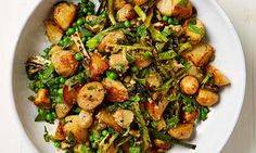 Yotam Ottolenghi's new potatoes with burnt spring onion and peas. https://www.theguardian.com/lifeandstyle/2017/may/27/potato-recipes-harissa-roast-salt-cod-fishcakes-new-spring-onion-peas-yotam-ottolenghi