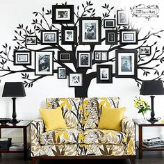 Could do a DIY version of this wall sticker - just paint and tree on your wall and attached picture frames!