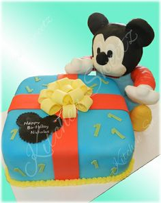 Baby Mickey Mouse Cake - Present is Cake and Mickey is Rice Krsipies. Custom made by: www.kitchensweetz.com