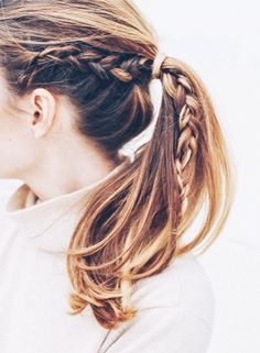 For another upgrade to the average ponytail, try creating a small braid at the side of your head, continuing down to the roots, and securing with a clear elastic hair tie ($6). Next, gather the...