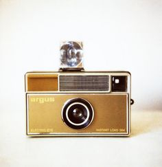 flashcube! and film!  It took a week to get back your lousy pictures and you couldn't just hit the delete button if you hated the way you looked.