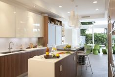 Houzz Tour: Modern, Entertaining Home in Florida Creative wall treatments, bright colors and ever-present extended family make a modern renovation a lively affair