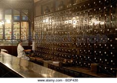 Druggist in an old Chinese pharmacy with an antique apothecary cabinet, Tunxi, Huangshan Shi, Anhui Province, China, - Stock Photo