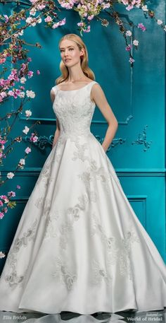 Simplicity and elegance are expertly combined in this full A-line dress. Distinctive cut out lace embroidery is the highlight of this gown, a jaw-dropping detail that really sets it apart from the rest. The luxurious structured Mikado of this dress creates a divinely clean silhouette, complemented by the off the shoulder strap detailing. Pure charm.