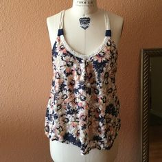 """Floral tank top Xhilaration tank top. Cream tank with a navy, cream and peach floral lace front. Very flowy. Extremely soft...100% rayon body, 100% polyester lace. 2 cute little buttons at center front. From center front down 17.5"""".  From underarm down 14.5"""". From center back down 24"""". Bust laying flat, 20.5. Worn once. Xhilaration Tops Tank Tops"""