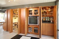 Transform your Man Cave with the help of ShelfGenie of Southfield, MI!  Call (248) 420-3903 for a FREE design consultation or visit our website www.shelfgenie.com/southfield for more information!