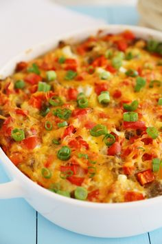 English Muffin Sausage, Egg and Cheese Breakfast Casserole with @ThomasBreads – So delicious and easy! Topped with salty sausage, scrambled eggs and cheddar. thecomfortofcooking.com