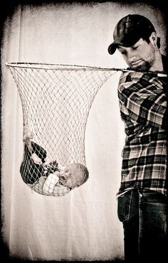 a keeper...cute idea for the daddy that loves fishing...buy a new fishing net & don't put baby in your dirty used one