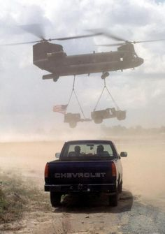A U.S. Army National Guard CH-47 Chinook helicopter from the Detachment 1, Company F, 106th Aviation Davenport, Iowa carries a sling load of the last HMMWV and water buffalo, along with U.S. flag that flew over the Kumaka site, airlifted back to Camp Stephenson, U.S. military engineers renovated the Kumaka Regional Hospital and improved the airstrip runway as part of this first combined humanitarian and civic assistance exercise conducted between the United States and Guyana.