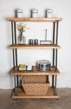 Combining the look of modern industrial metal with the warmness of a reclaimed wood style, this industrial pipe shelving bookcase will be sure to Pipe Bookshelf, Diy Pipe Shelves, Rustic Bookshelf, Wood Bookshelves, Bookshelf Design, Bookcase, Pipe Shelving, Pipe Desk, Bookshelf Plans