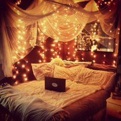 Utilizing lights as decorations in a bedroom looks so pretty!