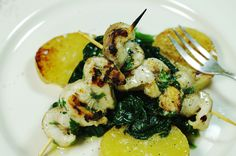 sturgeon skewers with potatoes and spinach