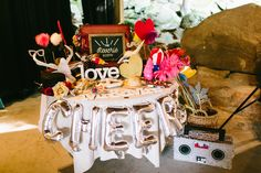 The Reverie Booth's prop table set-up for an all-American rustic wedding