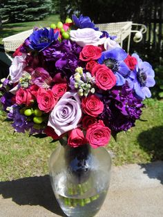 Bridal bouquet featuring purple and pink flowers created by Lexington Floral in Shoreview, MN .    #wedding #bride #flowers