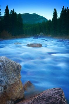 Maligne River Through The Rocky Mountains, Jasper National Park, Canada; photo by Corey Hochachka