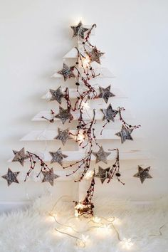 Wooden White Christmas tree with stars and light. Wooden Christmas Trees, Noel Christmas, Rustic Christmas, Christmas Projects, All Things Christmas, Winter Christmas, Christmas Ornaments, Homemade Christmas, Alternative Christmas Tree