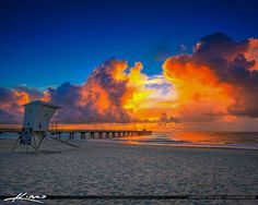 Crazy colors illuminating the clouds at the Pompano Beach Pier during sunrise over Broward County, Florida. HDR image created using Aurora HDR 2017.