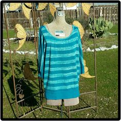 Teal 3/4 Sleeve Sweater Light and dark teal colored with 3/4 sleeves sweater. Can be worn off shoulder or on or one shoulder.  Looks good with a belt also. Has a wide band around bottom and around sleeves. Round neck. Has been worn but all in good condition. Zenana Outfitters Sweaters