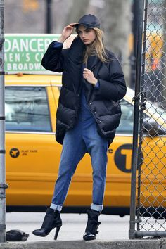 Cara wearing a puffer jacket in NYC.
