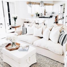 home love all the natural elements and the comfortable slip covered furniture. also the color pallet