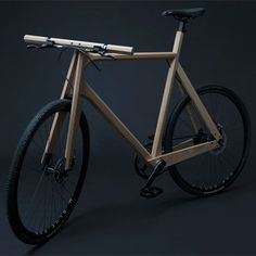 Wooden bicycle by Paul Timmer. Wooden bicycle from solid ash fitted with 3D-printed aluminium parts.