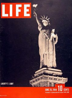1944 original vintage Life magazine cover. Entitled Liberty's Light with view of the Statue of Liberty on Liberty Island at night.