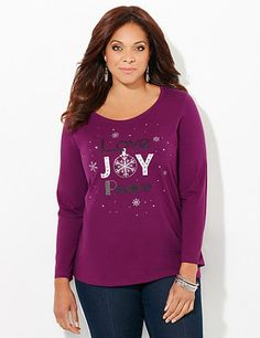 Our festive tee gets you in the spirit of the season with its shimmer design. The center graphic shows a sparkling holiday scene made of studs and inspirational words of the season. Scoop neckline. Long sleeves. Catherines tops are designed for the plus size woman to guarantee a flattering fit. catherines.com