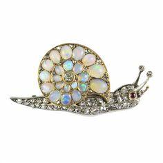 A Victorian opal and diamond snail brooch