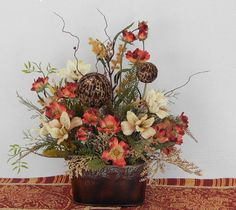 Tuscan Floral Arrangement with Popppies and Feather Ball Stems, Lilies Orange Brown Rust Cream, Tabletop Arrangement, Silk Floral Arrangement, Every Day Arrangement    A beautiful three sided arrangement that can be displayed just about anywhere! The first picture that I have listed features it displayed on the counter in my kitchen. I wanted you to see how nice it looks with Tuscan colors for those of you who love to decorate Tuscany!    The beautiful medium and mini size poppies add a…