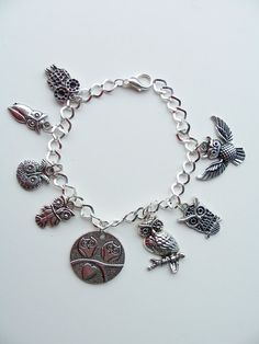 Owl themed charm bracelet  by SparkleandComfort, $20.00