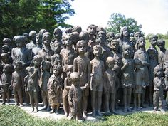 Memorial to the murdered children of Lidice.  Their survived mothers didn't want the faces of statues to resemble their children, so the sculptor made their features quite generalized.