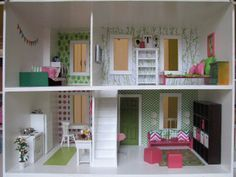 Lucky me I found a Free wooden dollhouse on craigslist, once I paint over the crayon marks, I'm hoping it will be something like this!