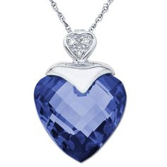 A stunning blue sapphire with checker board faceting cut into the shape of a heart for this pendant....