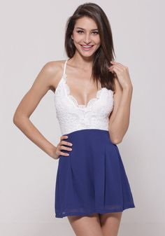 This blue & white lace romper features geometric crochet white top and blue chiffon bottom, a plunging neckline and a very sexy crisscross back. | Lookbook Store Jumpsuits and Rompers Collection