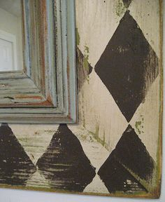 great idea to make a mirror larger - put on top of painted plywood