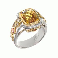 Jane Wullbrandt Signature Spectrum ring....we have 1 left with garnet center stone!