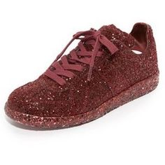 One pair of glitter sneakers you're bound to see on every fashion girl this season? The  Maison Margiela Sneakers ($725).