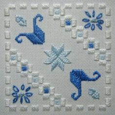 Fabric: 22ct White Hardanger<br />Threads: DMC perle #5 & #8 & stranded cotton (White, various blues)