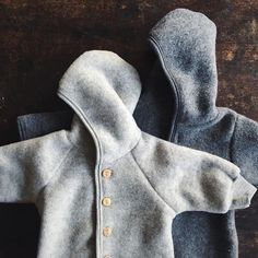 The light and dark grey wool fleece together! Both in stock as jackets and the softest baby snugglesuits! Dark grey is exclusive to us! #woolfleece #engelnatur