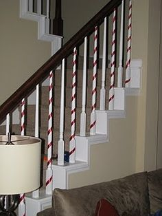 Love how she decorated her banister - turning the rails into candy canes with red packaging ribbon.