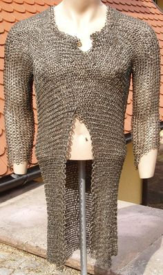 European (German) riveted mail hauberk, 15th century, at the neck opening is a brass maker`s mark with gothic minuscules and three Maltese crosses, these brass marks can show the makers name and / or the town, it is constructed with more than 25.000 riveted rings. Length 88 cm. Weight  8.6 kg. The members of the German guild who made hauberks were called `Panzermacher´and in later centuries all  goods made of wire were still called `Panzerwaren. H19.
