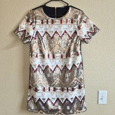 Super Cute Tribal Sequined Dress!! New w/o tags short party dress!! Just bought this dress at a local boutique but didn't try it on and it was too short for my comfort!! Since I took off the tag, I couldn't return it!! NO TRADES ❗️OFFERS THRU OFFER BUTTON ONLY❗️All offers welcomed!! Dresses Mini