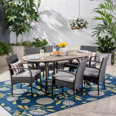 The beautiful blend of wood and wicker comes to life with this dining set. Complete with 6 wicker dining chairs and 1 wooden table, you can enjoy eating in your backyard whenever you want. The wooden table is treated to withstand even the harshest of Wicker Dining Chairs, Outdoor Wicker Furniture, Wooden Dining Tables, Outdoor Dining Set, Patio Dining, Beige Cushions, Silver Cushions, Cream Cushions, Seasons