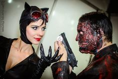 Brazilian cosplayers Mel Rayzel as Catwoman and Rauber Soares as Two-Face at Fest Comix 2014 - São Paulo, Brazil. Photo by Eduardo Portas