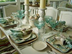 Beach inspired table setting Tablescape Centerpiece www.tablescapesbydesign.com https://www.facebook.com/pages/Tablescapes-By-Design/129811416695