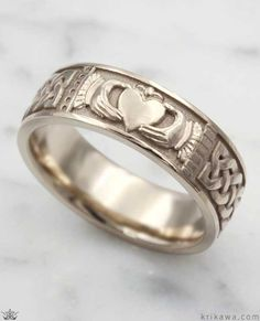 The Claddagh is a traditional Irish symbol representing love, loyalty and friendship. In our Claddagh ring, we wrapped a Celtic knot pattern from edge-to-edge of the symbol. This makes a great set with the Claddagh Engagement Ring! Claddagh Engagement Ring, Claddagh Rings, Claddagh Wedding Ring, Mens Claddagh Ring, Diamond Claddagh Ring, Irish Wedding Rings, Titanium Jewelry, Titanium Rings, Jewelry Tags