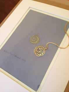 Bespoke gold asymmetric pendant photographed with the working drawing I gave the client. It was inspired by an Art Nouveau fern pattern.